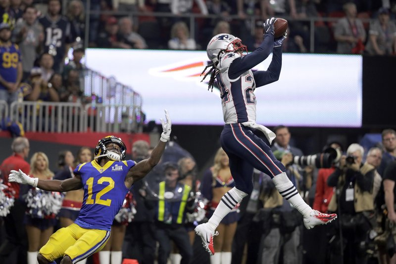 New England Patriots' Stephon Gilmore, right, intercepts a pass intended for Los Angeles Rams' Brandin Cooks (12) during the second half of the NFL Super Bowl 53 football game Sunday, Feb. (AP Photo/Chuck Burton)