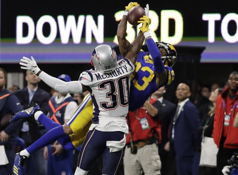 New England Patriots' Jason McCourty (30) breaks up pass intended Los Angeles Rams' Josh Reynolds (83), during the first half of the NFL Super Bowl 53 football game Sunday, Feb. (AP Photo/Frank Franklin II)
