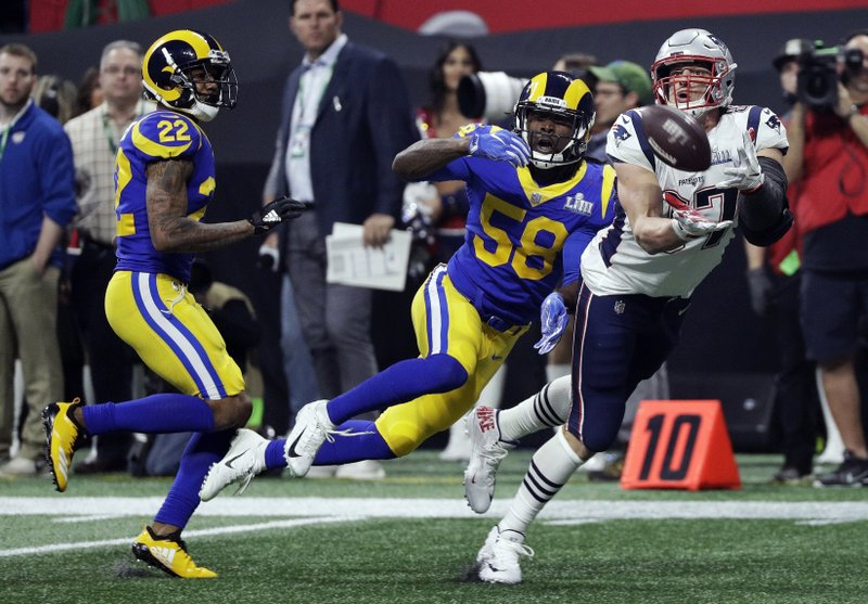 New England Patriots' Rob Gronkowski (87) catches a pass in front of Los Angeles Rams' Marcus Peters (22) and Cory Littleton (58) during the second half of the NFL Super Bowl 53 football game Sunday, Feb. (AP Photo/David J. Phillip)