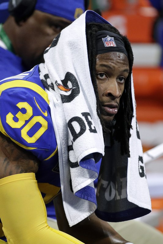 Los Angeles Rams' Todd Gurley II watches from the bench during the first half of the NFL Super Bowl 53 football game against the New England Patriots, Sunday, Feb. (AP Photo/Patrick Semansky)