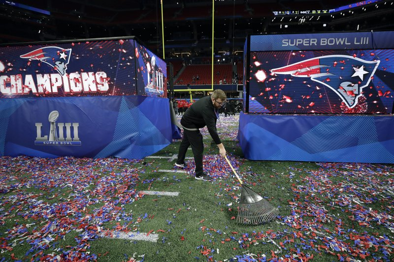 Paul Hitselberger rakes confetti on the Mercedes-Benz Stadium turf after the NFL Super Bowl 53 football game between the Los Angeles Rams and the New England Patriots Sunday, Feb. (AP Photo/David J. Phillip)