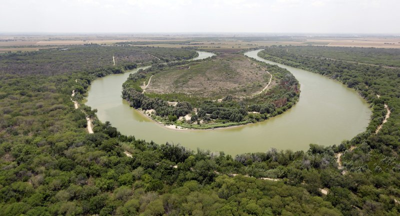 FILE - In this July 24, 2014, file photo, a bend in the Rio Grand is viewed from a Texas Department of Public Safety helicopter on patrol over in Mission, Texas. (AP Photo/Eric Gay, Pool, File)