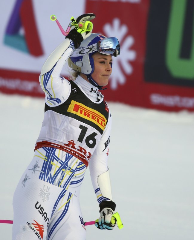 United States' Lindsey Vonn waves as she arrives at the finish area after crashing during the women's super G during the alpine ski World Championships, in Are, Sweden, Tuesday, Feb. (AP Photo/Marco Trovati)