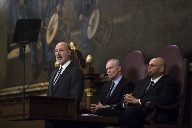 Democratic Gov. Tom Wolf, left, delivers his budget address for the 2019-20 fiscal year to a joint session of the Pennsylvania House and Senate in Harrisburg, Pa. (AP Photo/Matt Rourke)