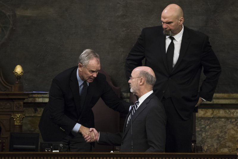 Democratic Gov. Tom Wolf, center, shakes hands with House Speaker Mike Turzai, R-Allegheny, left, as Lt. (AP Photo/Matt Rourke)