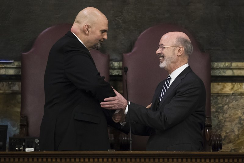 Democratic Gov. Tom Wolf, right, shakes hands with Lt. Gov. John Fetterman before he delivers his budget address for the 2019-20 fiscal year to a joint session of the Pennsylvania House and Senate in Harrisburg, Pa. (AP Photo/Matt Rourke)