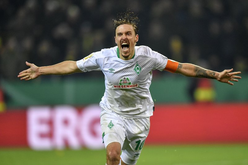 Bremen's Max Kruse celebrates after scoring the last penalty of the German soccer cup, DFB Pokal, match between Borussia Dortmund and Werder Bremen in Dortmund, Germany, Tuesday, Feb. (AP Photo/Martin Meissner)
