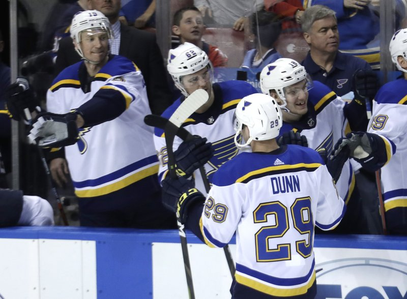 St. Louis Blues defenseman Vince Dunn (29) is congratulated after scoring the game-winning goal during the third period of an NHL hockey game against the Florida Panthers, Tuesday, Feb. (AP Photo/Lynne Sladky)