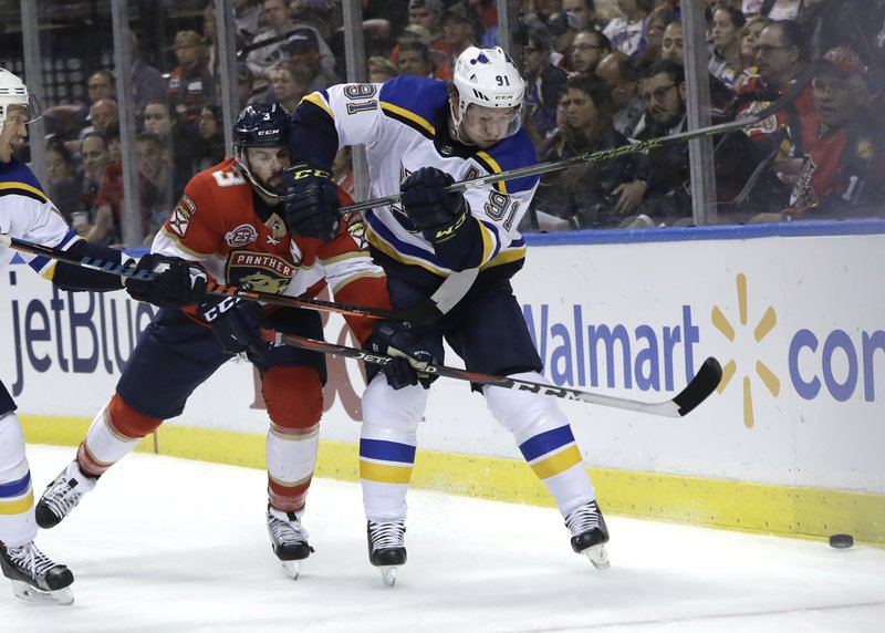 Florida Panthers defenseman Keith Yandle (3) and St. Louis Blues right wing Vladimir Tarasenko (91) go for the puck during the second period of an NHL hockey game, Tuesday, Feb. (AP Photo/Lynne Sladky)