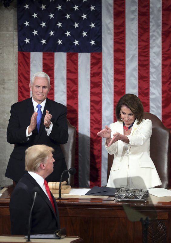 President Donald Trump turns to House speaker Nancy Pelosi of Calif., as he delivers his State of the Union address to a joint session of Congress on Capitol Hill in Washington, as Vice President Mike Pence watches, Tuesday, Feb. (AP Photo/Andrew Harnik)