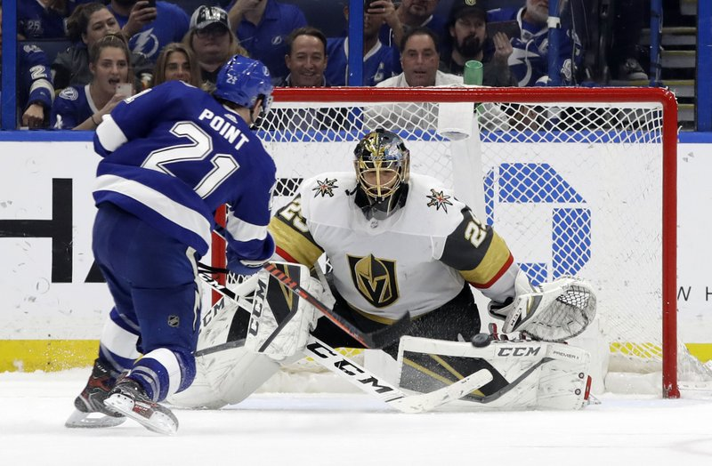 Vegas Golden Knights goaltender Marc-Andre Fleury (29) stops a shot by Tampa Bay Lightning center Brayden Point (21) during a shootout in an NHL hockey game Tuesday, Feb. (AP Photo/Chris O'Meara)