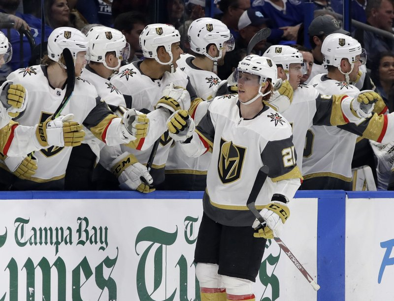 Vegas Golden Knights center Cody Eakin (21) celebrates with the bench after his goal against the Tampa Bay Lightning during the second period of an NHL hockey game Tuesday, Feb. (AP Photo/Chris O'Meara)