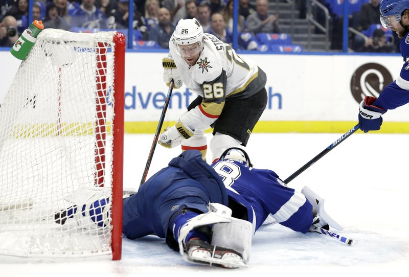 Tampa Bay Lightning goaltender Andrei Vasilevskiy (88) stretches out to stop a shot by Vegas Golden Knights center Paul Stastny (26) during the first period of an NHL hockey game Tuesday, Feb. (AP Photo/Chris O'Meara)