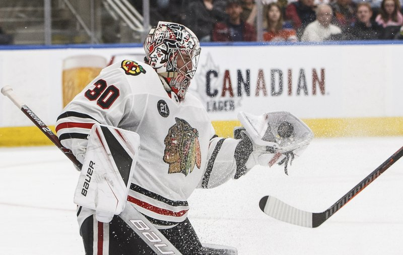 Chicago Blackhawks goalie Cam Ward makes a save against the Edmonton Oilers during the second period of an NHL hockey game Tuesday, Feb. (Jason Franson/The Canadian Press via AP)