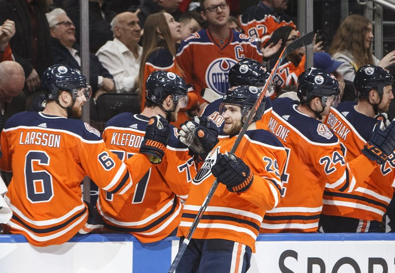 Edmonton Oilers' Leon Draisaitl (29) celebrates a goal against the Chicago Blackhawks during the first period of an NHL hockey game Tuesday, Feb. (Jason Franson/The Canadian Press via AP)