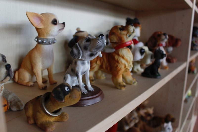 In this Jan. 8, 2019 photo, dog bobbleheads are displayed at the National Bobblehead Hall of Fame and Museum in Milwaukee. (AP Photo/Carrie Antlfinger)