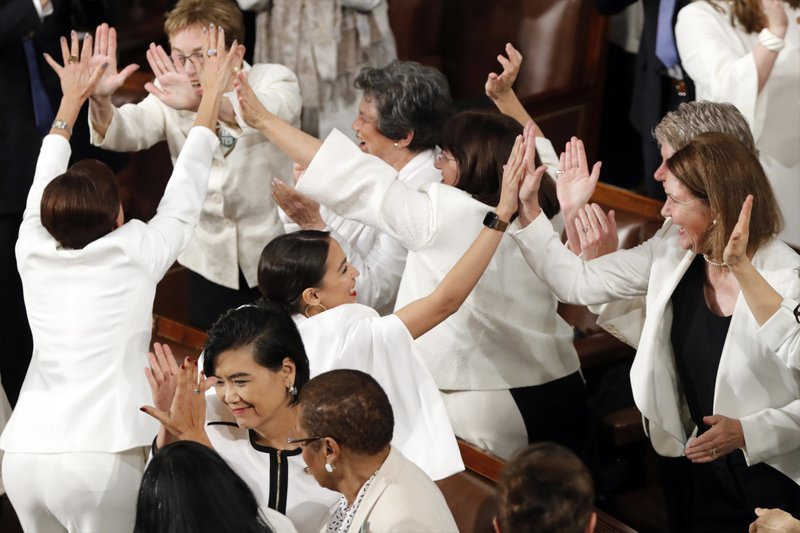 Women members of Congress, including Rep. Alexandria Ocasio-Cortez, D-N.Y., center, cheer after President Donald Trump acknowledges more women in Congress during his State of the Union address to a joint session of Congress on Capitol Hill in Washington, Tuesday, Feb. (AP Photo/J. Scott Applewhite)