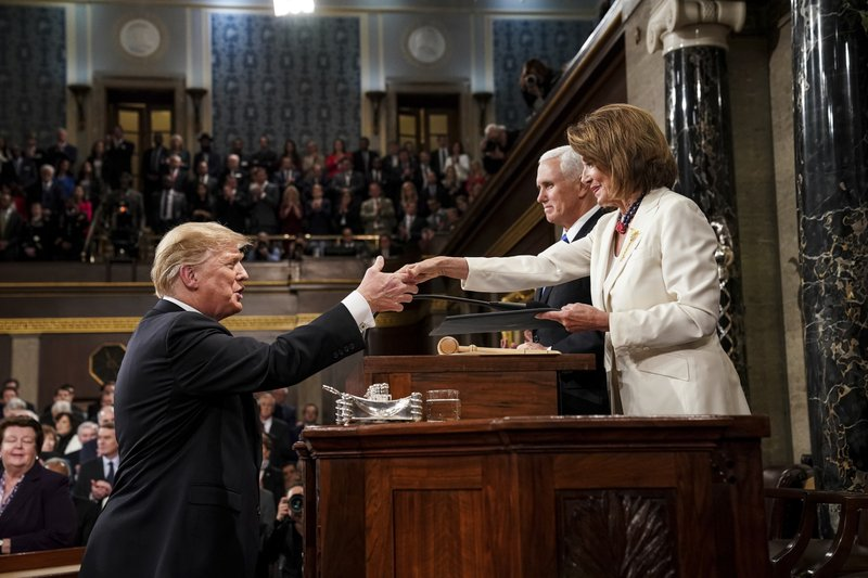 President Donald Trump shakes hands with House Speaker Nancy Pelosi as Vice President Mike Pence looks on, as he arrives in the House chamber before giving his State of the Union address to a joint session of Congress, Tuesday, Feb. (Doug Mills/The New York Times via AP, Pool)