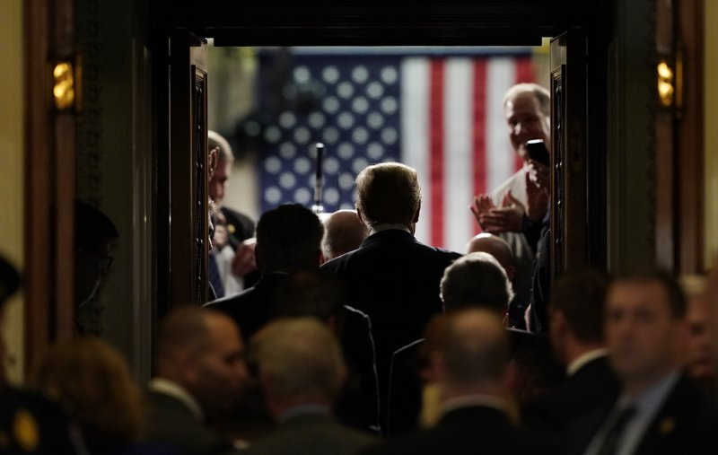 President Donald Trump arrives to deliver his State of the Union address to a joint session of Congress on Capitol Hill in Washington, Tuesday, Feb. (AP Photo/Carolyn Kaster)