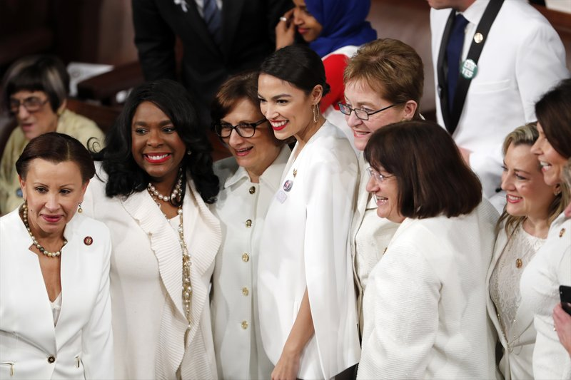 Democratic members of Congress, including Rep. Alexandria Ocasio-Cortez, D-N.Y., center, pose for a photo before President Donald Trump delivers his State of the Union address to a joint session of Congress on Capitol Hill in Washington, Tuesday, Feb. (AP Photo/J. Scott Applewhite)