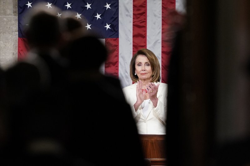 House Speaker Nancy Pelosi, claps on the House floor as guests are announced as they arrive prior to President Donald Trump arriving and delivering his State of the Union address to a joint session of Congress on Capitol Hill in Washington, Tuesday, Feb. (AP Photo/Carolyn Kaster)
