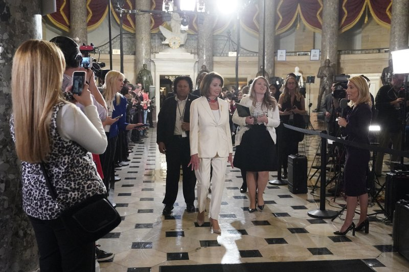 House Speaker Nancy Pelosi of Calif, arrives to listen to President Donald Trump deliver his State of the Union address to a joint session of Congress on Capitol Hill in Washington, Tuesday, Feb. (AP Photo/Carolyn Kaster)