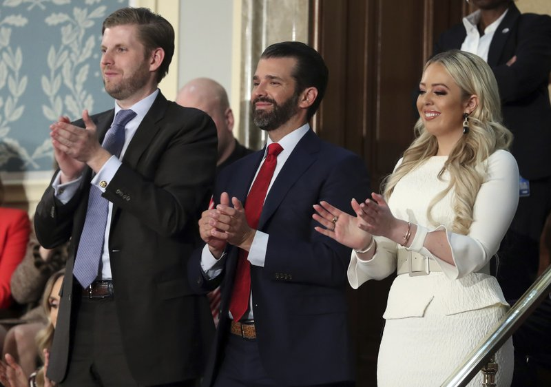 Eric Tump, left, Donald Trump Jr., center and Tiffany trump applaud as President Donald Trump delivers his State of the Union address to a joint session of Congress on Capitol Hill in Washington, Tuesday, Feb. (AP Photo/Andrew Harnik)
