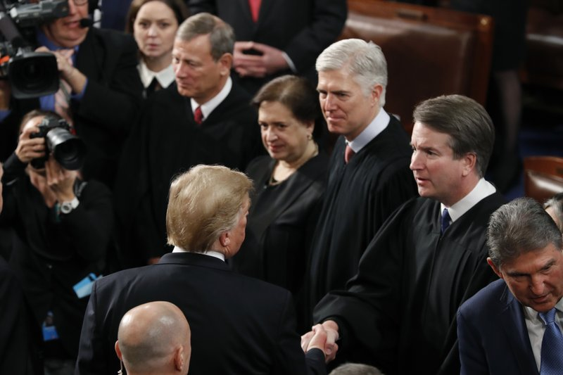 President Donald Trump shakes hands with Supreme Court Justice Brett Kavanaugh, after delivering his State of the Union address to a joint session of Congress on Capitol Hill in Washington, Tuesday, Feb. (AP Photo/J. Scott Applewhite)