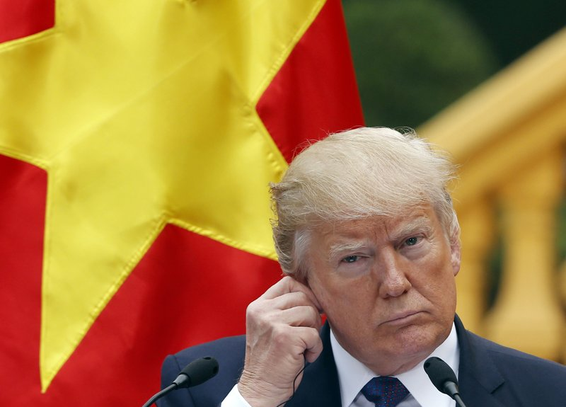 FIE - In this Nov. 12, 2017, file photo, U.S. President Donald Trump attends a press conference at the Presidential Palace in Hanoi, Vietnam. (Kham/Pool Photo via AP, File)