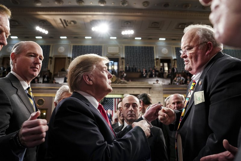 President Donald Trump takes with Rep. Billy Long, R-Mo., after giving his State of the Union address to a joint session of Congress, Tuesday, Feb. (Doug Mills/The New York Times via AP, Pool)