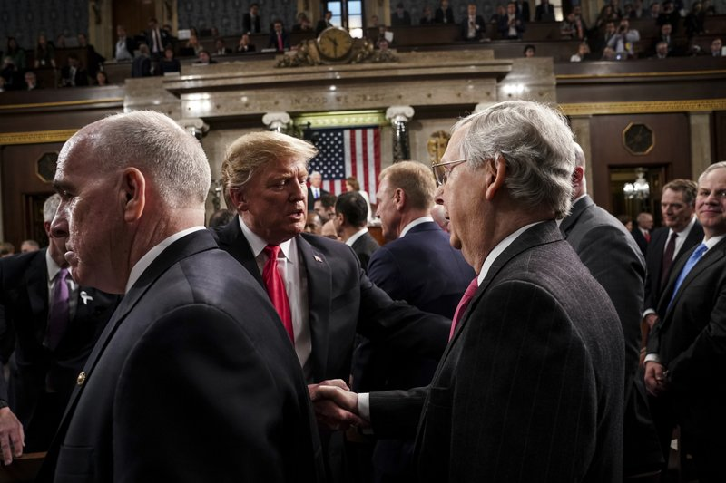 President Donald Trump talks to Senate Majority leader Mitch McConnell while leaving the House chamber after giving his State of the Union address to a joint session of Congress, Tuesday, Feb. (Doug Mills/The New York Times via AP, Pool)