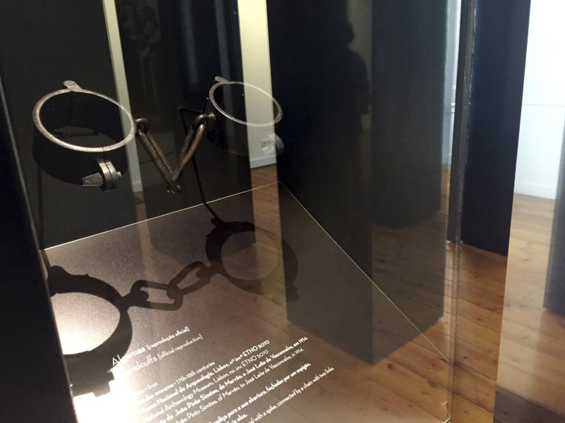In this June 27, 2018 photo, chains once used to hold slaves are displayed at El Mercado de Escravos, or the Slave Market, which now serves as a museum to slavery in Lagos, Portugal. (AP Photo/Russell Contreras)