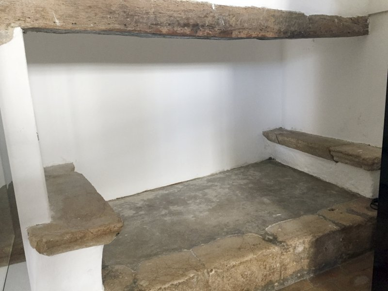 In this June 27, 2018 photo, a bench where slaves reportedly sat before being sold is shown at El Mercado de Escravos, or the Slave Market, which now serves as a museum in Lagos, Portugal. (AP Photo/Russell Contreras)