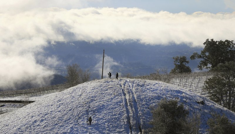 Kendall-Jackson vineyards are covered in snow along the foot of Black Mountain, above the Alexander Valley near Geyserville, Calif. (Kent Porter/The Press Democrat via AP)