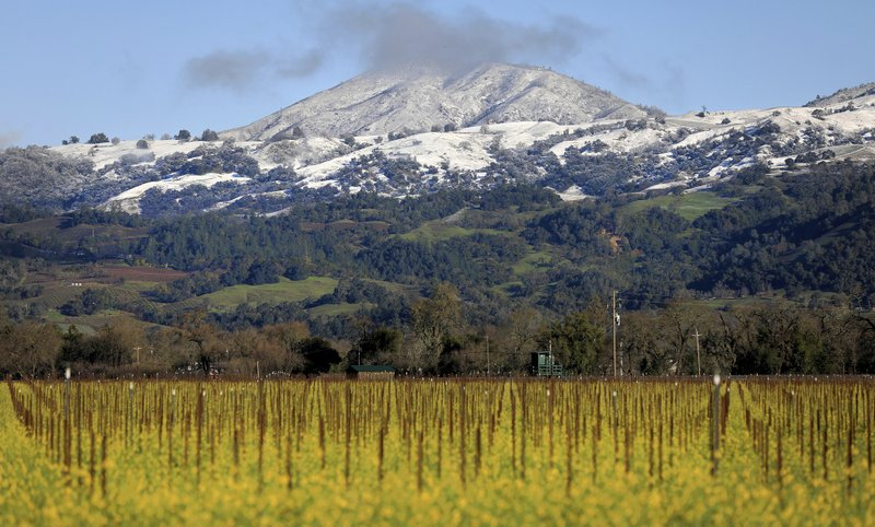 The valley floor says spring, Geyser Peak and the surrounding foothills embrace winter above Alexander Valley, Tuesday, Feb. (Kent Porter/The Press Democrat via AP)