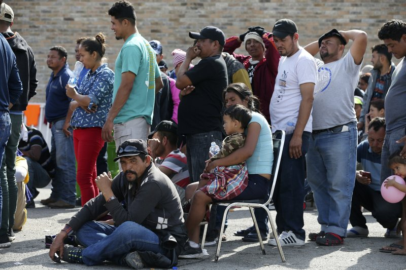 Central American immigrants line up to register with Mexican Immigration officials at a shelter in Piedras Negras, Mexico, Tuesday, Feb. (Jerry Lara/The San Antonio Express-News via AP)