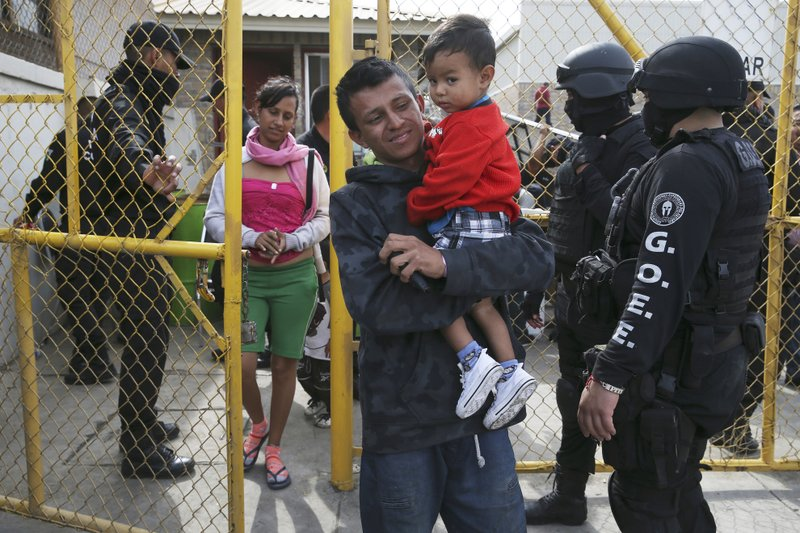 Members of a Central American family leave a shelter in Piedras Negras, Mexico, Tuesday, Feb. 5, 2019. (Jerry Lara/The San Antonio Express-News via AP)