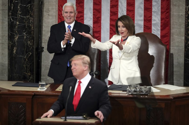 House Speaker Nancy Pelosi gestures to fellow Democrats as President Donald Trump acknowledges women in Congress during his State of the Union address to a joint session of Congress on Capitol Hill in Washington, Tuesday, Feb. (AP Photo/Andrew Harnik)