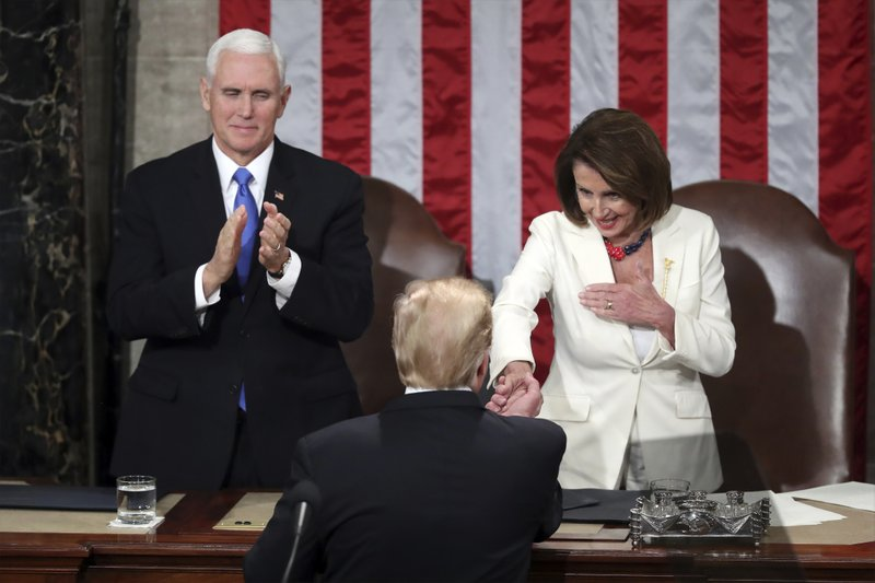 President Donald Trump shakes hands with House speaker Nancy Pelosi after he delivered his State of the Union address to a joint session of Congress on Capitol Hill in Washington, as Vice President Mike Pence watches, Tuesday, Feb. (AP Photo/Andrew Harnik)