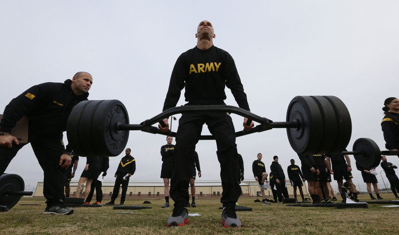 In this Jan. 8, 2019, photo, U.S Army 1st Lt. Mitchel Hess participates in a weight lifting drill while preparing to be an instructor in the new Army combat fitness test at Fort Bragg, N. (AP Photo/Gerry Broome)