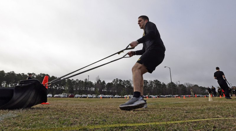 In this Jan. 8, 2019, photo, U.S Army Capt. Aaron Lopez participates while preparing to be an instructor in the new Army combat fitness test at Fort Bragg, N. (AP Photo/Gerry Broome)