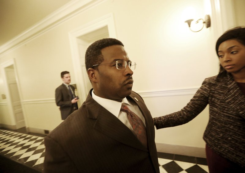 Del. C.E. Cliff Hayes, Jr., D-Chesapeake, leaves the Democratic Caucus meeting Wednesday, Feb. 6, 2019, in Richmond, Va. (Steve Earley/The Virginian-Pilot via AP)