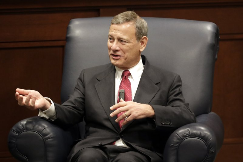 Supreme Court Chief Justice John Roberts answers questions during an appearance at Belmont University Wednesday, Feb. (AP Photo/Mark Humphrey)