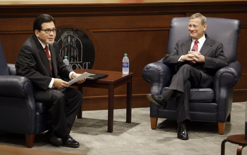Supreme Court Chief Justice John Roberts, right, takes part in a forum with Belmont University Law Dean Alberto Gonzales, left, at Belmont University Wednesday, Feb. (AP Photo/Mark Humphrey)