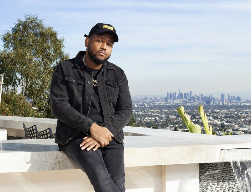 "In this Jan. 24, 2019 photo, Boi-1da poses for a portrait in Los Angeles. The Jamaica-born, Toronto-raised producer is nominated for six Grammys including three in the best rap song category, for his work on Drake's ""God's Plan, Eminem's ""Lucky You"" and Jay Rock's ""Win."" (Photo by Rebecca Cabage/Invision/AP)"
