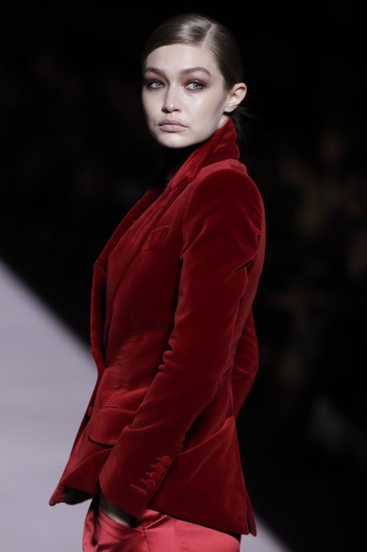 Gigi Hadid models fashion from the Tom Ford collection during Fashion Week, Wednesday, Feb. 6, 2019, in New York. (AP Photo/Julio Cortez)