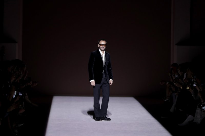 Fashion designer Tom Ford appears on the runway after showing his latest collection during Fashion Week, Wednesday, Feb. (AP Photo/Julio Cortez)
