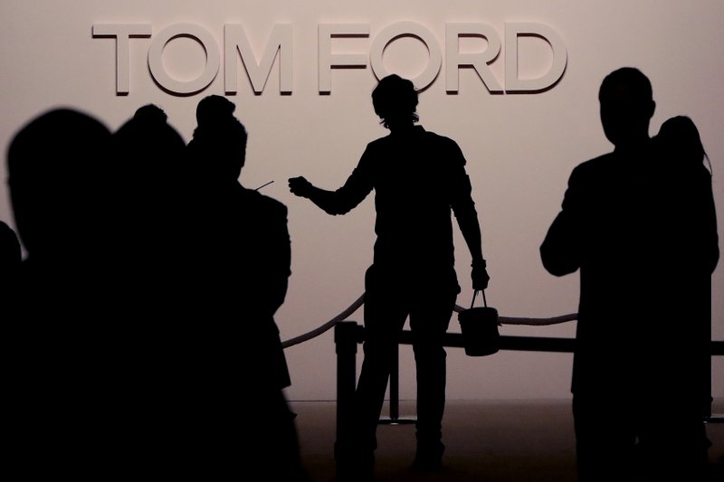Finishing touches are made to the main entrance prior to a show displaying the Tom Ford collection during Fashion Week, Wednesday, Feb. (AP Photo/Julio Cortez)