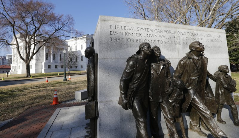 In this Feb. 5, 2019, photo, a statue commemorating the African-American students whose 1951 school walkout became a key moment in the civil-rights movement sits on the grounds of the Capitol in Richmond, Va. (AP Photo/Steve Helber)