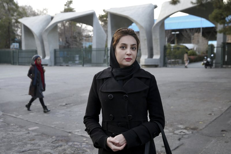 In this Tuesday, Jan. 29, 2019 photo, Mania Filum, a 27-year-old university student, is interviewed by The Associated Press about Iran's 1979 Islamic Revolution, in downtown Tehran, Iran. (AP Photo/Ebrahim Noroozi)